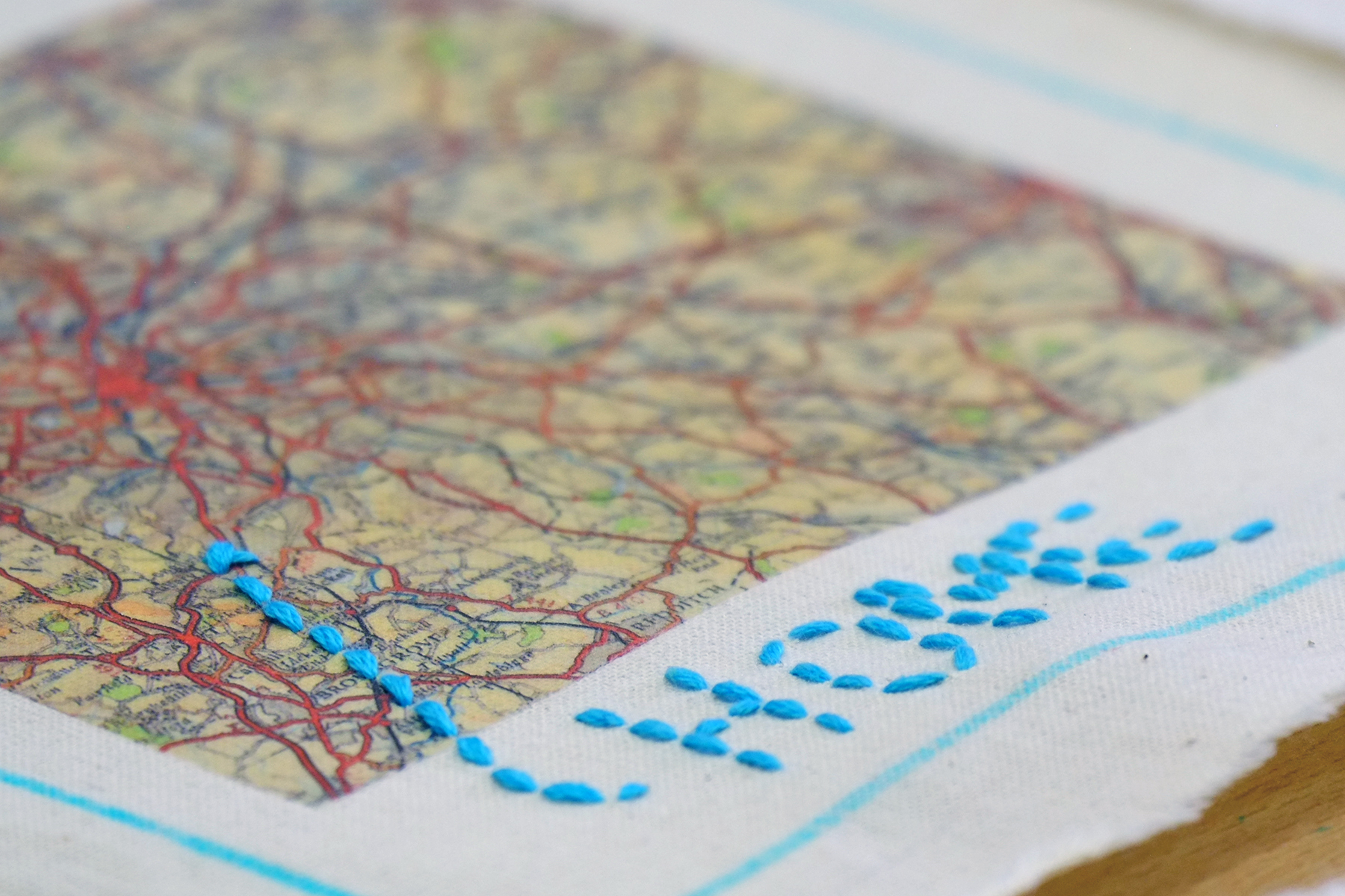 Map embroidered with the word 'home'