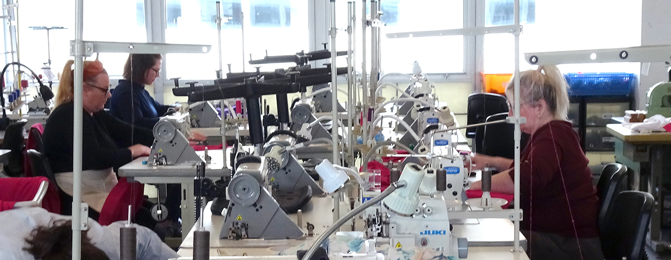 People using industrial sewing machines