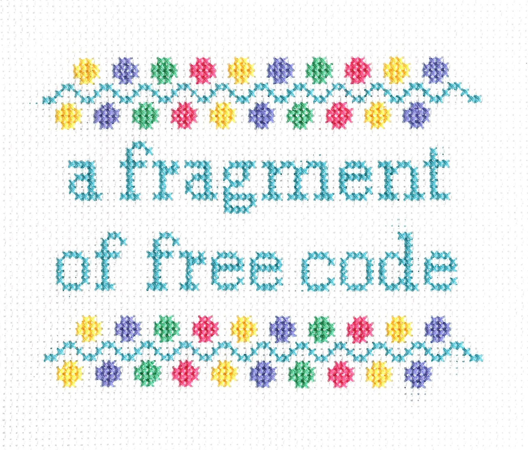 embroidered text: 'a fragment of free code'