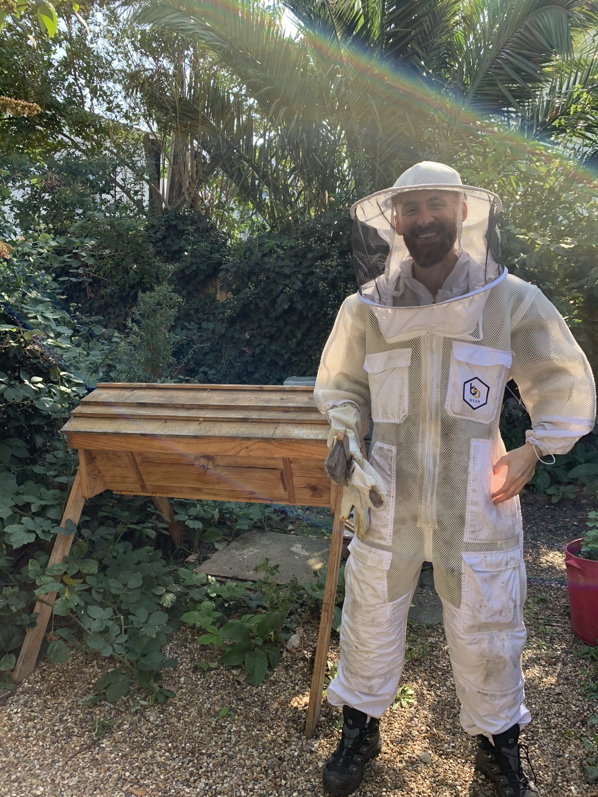 man wearing beekeeping outfit