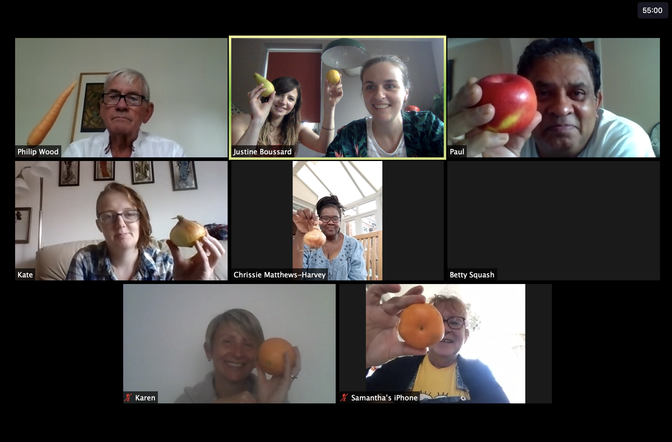 People on a video call holding fruit and vegetables